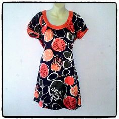BCBG MAXAZRIA Tunic or short dress Black orange pattern. Material is 96% poly and 4%spandex. 2 button closure in the back. Excellent like new condition. BCBGMaxAzria Dresses Mini
