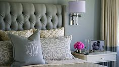 Tufted, upholstered wing-back bed with sconce lighting