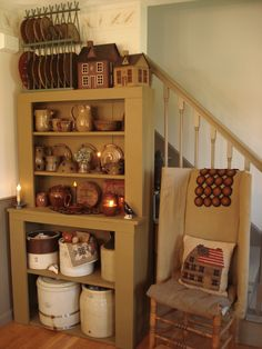 Prim Gathering...by the stairs...cupboard with old crocks & dishes.