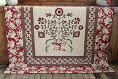 Penny Rose Quilt Pattern will keep you interested from start to finish. Lone Star Blocks in the corners, square in a square block borders and a beautiful applique center piece. Finished Measurement: 73 inches x 73 inches