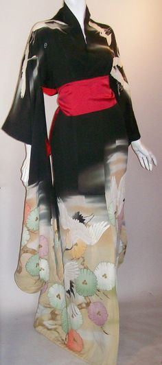 1920s wedding kimono, or uchikake, from the Taisho or Showa era. Puffs of pine needles set off painted gold pine cone clusters, white cranes float gracefully amongst wisps of clouds. All hand painted, lined in red silk. No sash as they weren't worn as such (shown with scarf to define waist). Padded cord within hem.