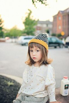 Mustard + black & white striped hat, cream & gold dot top. Italian toddler fashion.