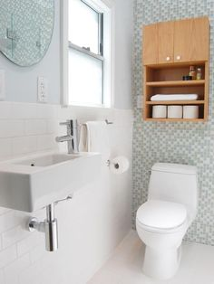 Lots of white. I like the contrast of the wood to the other materials. Modern Bathrooms from Jennifer Jones on HGTV