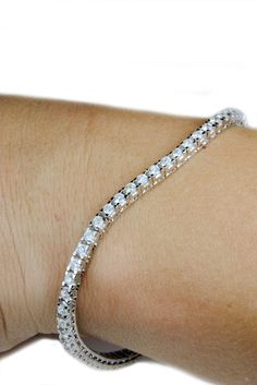 A bespoke diamond tennis bracelet I photographed for our website. 61 brilliant cut VS, G coloured diamonds claw set in 18ct white gold. 3cts in total. This elegant piece of jewellery is reputed to be named after an incident in 1987 when tennis star Chris Evert lost her diamond line bracelet during the U.S. Open. The game was halted as she searched the court for the missing bracelet. Our tennis bracelets have safety clasps to prevent such a thing happening to you!