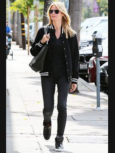 Heidi Klum's classic bomber jacket looks even more badass paired with traditional aviator sunnies and high-top sneaks!