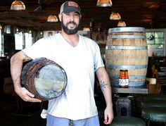 CIC alum Geoff Rhyne, sous chef at Leon's Fine Poultry & Oyster Shop, carries a High Wire Distilling sorghum whisky barrel filled with his with Red Clay sauce. Story here: http://www.postandcourier.com/article/20140916/PC1206/140919549