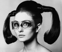 A model wearing space age glasses, New York City, March 1967. S)
