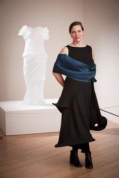 "Artist Karen LaMonte with her cast-glass sculpture ""Dress Impression with Wrinkled Cowl""  crystalbridges.org"