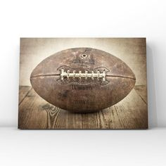 This listing is for One print of a 1950s vintage football. This would be a perfect print for your little boys room or a nursery. If youd like the grey background version of this please just list that in the notes to seller section when you check out.  Please select either photo or canvas as well as Vintage Sports Nursery, Vintage Nursery Decor, Vintage Sports Decor, Sports Themed Nursery, Football Nursery, Football Bedroom, Football Decor, Boys Football Room, Kids Room Wall Art