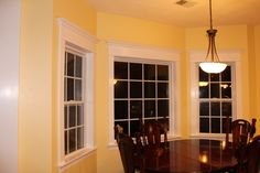 Window molding / casing with crown and painted white. Easy and inexpensive window treatment.