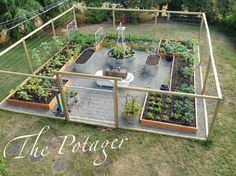 The Potager-I want something like this. The beds would be taller and the middle would have a small table and chair. Needs a roof with chicken wire and some kind of lighting