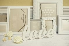 Seating chart using ornate frames with twig accents
