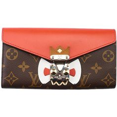Pre-owned Louis Vuitton Tribal Mask Sarah Monogram Coated Canvas... ($1,000) ❤ liked on Polyvore featuring bags, wallets, lock bag, flap wallet, print bags, hardware bag and monogram wallet