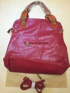 ELEGANT BRAND NEW crimson red side bag, with gold chains and a heart shaped zip with brown and orange handle. Easy to use and has a strap which is also included ideal for excessive luggage.