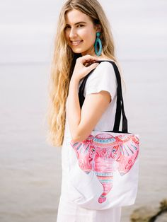 A sturdy tote bag with my own watercolour illustration printed on both sides. This boho design features a pink elephant with decorative splashes of orange and blue. Perfect for toting around your yoga gear or heading out to a picnic!