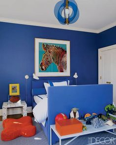 For the Young Man. A Gio Ponti light fixture and an Andy Warhol silkscreen. The East Hampton home of Aerin Lauder.