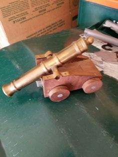 Vintage solid brass and wood miniature cannon replica