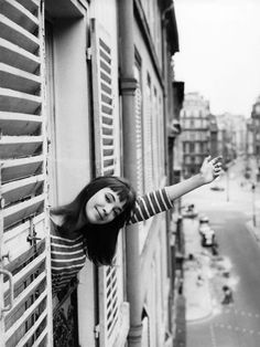 Darling of the French New Wave Anna Karina waves out the window of a Paris apartment building. 20 Insanely Chic Vintage Travel Photos to Inspire You via Anna Karina, Cola Light, Living Puppets, Happy Bastille Day, Louise Ebel, French New Wave, Diana Vreeland, Mode Inspiration, Vintage Travel