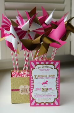 pinwheel centerpieces and party invite