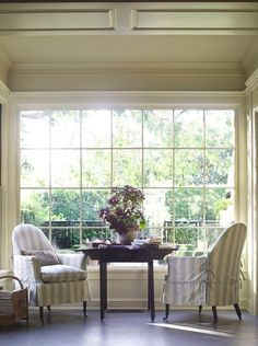 Love the intimate space created by the pair of chairs and drop leaf table--by Suzanne Rheinstein