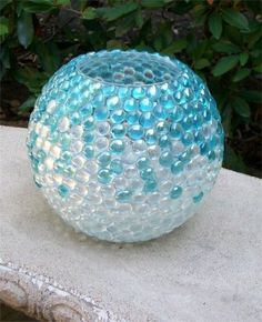 Glass jar or vessel, hot glue gun (clear) and flat glass beads, voila!