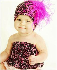 Baby Girl,  Leopard Dress and Headband....not my style for a baby but looks good on my board.