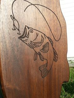 Router carving of largemouth bass on homemade black walnut fishing pole holder