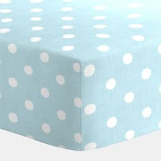 "Mist and White Polka Dot Crib Sheet from Carousel Designs.  Our fitted crib sheets feature deep pockets and have elastic all the way around the edges to hug mattresses securely. Fits standard crib mattresses, measuring approximately 28"" x 52""."