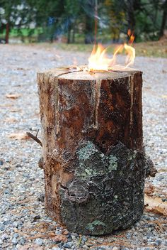 What you'll need:  - A log from the yard  - A chainsaw  - lighter fluid  - matches or a torch  using the chainsaw cut the log like a pizza.  Cut it about 1/2 to 3/4 the way through the log.  pour some lighter fluid down in the center and light her up!It will take a few minute for it to really get going.