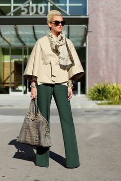 I have been lusting over this Banana Republic Cape since fall 08. Le sigh. The light tan looks great with those forest/teal pants. - Atlantic-Pacific