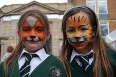 Face painting from by Kidz Paint.