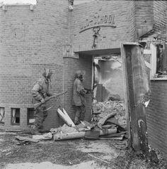 A Dutch school being searched for German snipers during Operation Market Garden, September 20, 1944