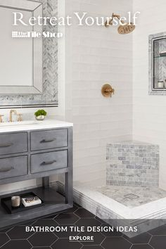 Trending now: making your space uniquely your own. The combination of materials, sizes and colors in this bathroom flows together seamlessly, in part because layering pieces smoothly transition from one tile to another. Tap to explore many more bathroom design ideas.