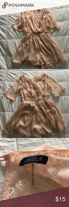 Romper with lace detail Bought but never worn. NWT uk2la Dresses Mini