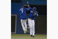 Jose Reyes and Emilio Bonifacio celebrate the Jays' victory.