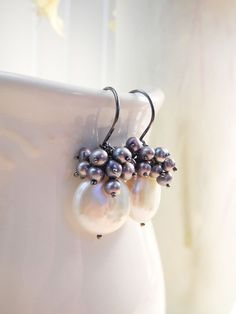 Freshwater Coin Pearl Earrings in Oxidized Sterling Silver, Handmade June Birthstone. $45.00, via Etsy.