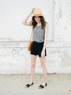Un-fancy. Grey top+black denim shorts+black flat sandals+canel crossbody bag+ivory and brown straw hat. Summer Casual Outfit 2017
