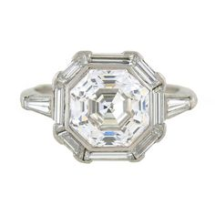 Art Deco 2.68 Carat GIA Cert Octagonal Step Cut Diamond Platinum Engagement Ring | From a unique collection of vintage engagement rings at https://www.1stdibs.com/jewelry/rings/engagement-rings/