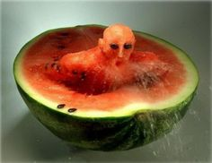 HE'S SWIMMING IN WATERMELON!!!!! Weird but cool <3 <3 <3 <3