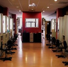 salon design/ red, black, & white colors with wood floors
