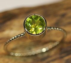 14K Gold Peridot Ring  Made To Order by louisagallery on Etsy    Oh I love this!!