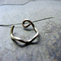 squiggly nose ring 18g custom hoop primitive by thebeadedlily