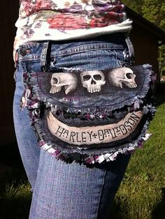 3 Skull 1 Bone Hip Bag by Modesty  ONE OF A KIND  This unique hip bag has a sweet purple plaid lining with one inside pocket. Closes securely using black velcro. On the back is a bone, ready for you name or motto. On the side has one bottom closed loop for you keys. Two clips can fasten to your belt loops or a strap.  Popular with bikers or anyone wishing to have a hands-free carrying pouch.  I also take custom orders.