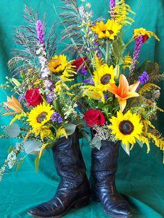 Custom, sympathy floral arrangement in cowboy boots.
