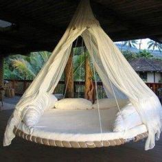 Swinging bed made out of an old trampoline!!! Are you fricken kidding me? this is totally cool!