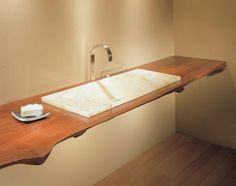 Google Image Result for http://modfrugal.com/wp-content/uploads/2010/07/western-art-and-architecture634x375wood-slab-with-onyx-verona_470.jpg