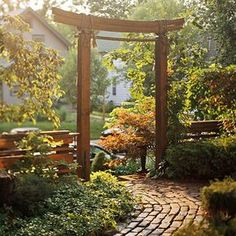 This Asian-inspired arbor would be a perfect element in any garden. I would incorporate many oriental elements in both the landscape and the inside decor of my dream home. The simplicity is absolutely elegant.