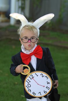 Love the White Rabbit Costume! Easy to make. Cardboard/ card stock clock. Bunny Ears. Oversized red bow tie. Some glasses.