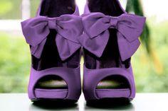 Purple peep-toe heels with bows