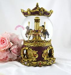 antique snowglobes  | ... Rain Forest musical box snow globe waterglobe - antique merry go round